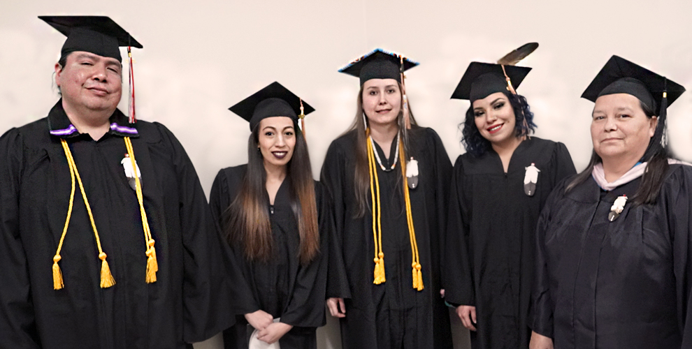 Graduates of the UTTC Business Administration BS program pose with Department Chair, Francine McDonald